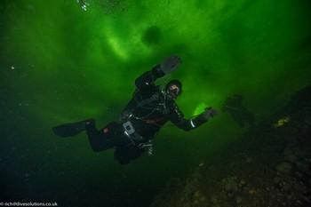 Ice diver below the ice in Russia. Rebreatherpro-Training
