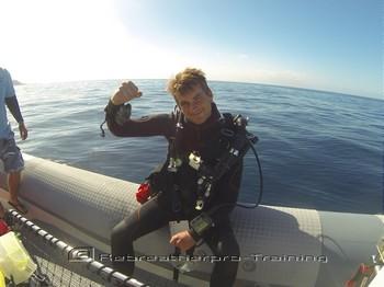 Rebreather diver celebrating passing his level 1 course Rebreatherpro-Training